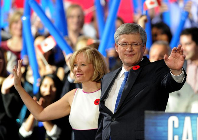Prime Minister Stephen Harper and his wife Laureen wave to the crowd at the Conservative Convention in Calgary, Alta., Friday, November 1, 2013. (Stuart Dryden/QMI Agency)