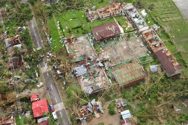 An aerial view shows damaged houses after Typhoon Haiyan hit Iloilo Province, central Philippines November 9, 2013.  REUTERS/Raul Banias