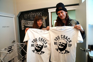 Stephanie Drabnik, of Cry Wolf, and artist Chris Aslanidis sell Rob Ford-inspired buttons and T-shirts in Ossington Ave in Toronto on Monday, November 11, 2013. (Michael Peake/Toronto Sun)