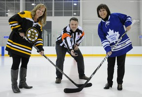W. BRICE MCVICAR The Intelligencer Sue Rollins, Belleville General Hospital Foundation event organizer (left) and Ana Bento, community manager for Scotiabank, wait for Bill Newman to drop the puck as part of the Scotiabank Legends of Hockey event. The foundation fundraiser, scheduled for January, will see Toronto Maple Leafs and Boston Bruins alumni team square off against one another.