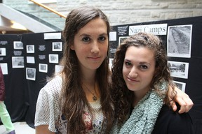 Queen's University students Zoey Katz, left, and Elana Moscoe are among the organizers of a Holocaust display set up on campus this week to mark Holocaust Education Week. Michael Lea The Whig-Standard
