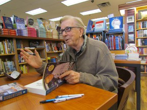 Former CTV anchor Loyd Robertson talks with fans while he signs a copy of his memoir, The Kind of Life It's Been, while visiting the Book Keeper bookstore Friday in Sarnia  PAUL MORDEN/ THE OBSERVER/ QMI AGENCY