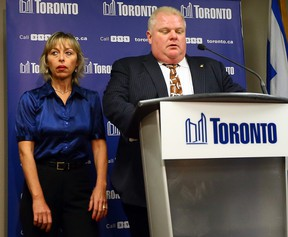 Toronto Mayor Rob Ford, alongside wife Renata, speaks to media to apologize for crude comments he made at City Hall on Nov. 14, 2013. (DAVE ABEL/Toronto Sun)