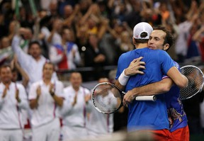 Czech Republic's Radek Stepanek (right) and Tomas Berdych celebrate after defeating Serbia's Nenad Zimonjic and Ilija Bozoljac in doubles during the Davis Cup World Group final in Belgrade November 16, 2013. (REUTERS/Stoyan Nenov)