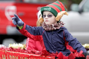 A boy throws candy from a float during the 32nd annual Consecon Santa Claus parade Sunday, Nov. 17, 2013. EMILY MOUNTNEY/THE INTELLIGENCER/QMI AGENCY