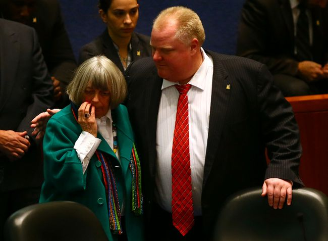 Councillor Pam McConnell nurses a fat lip while then-mayor Rob Ford hugs her after Ford barrelled into McConnell during a raucous city council meeting Monday, Nov. 18, 2013. (Dave Abel/Toronto Sun)