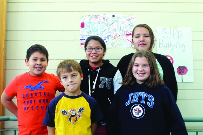 The members of the No Bully Zone at Pope John Paul II School in front of some of the anti-bullying posters they created and posted around their school. From L-R: Kendaaz White, Remington Clark, Rochelle Hunter, Serena Sinclair and Laura Polischuck.
