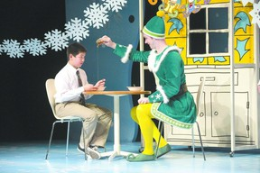 Liam Tobin pours maple syrup on Justin Eddy?s spaghetti in Elf, the musical, which is in previews until Nov. 28 and opens Nov. 29 at the Grand Theatre. (DEREK RUTTAN, The London Free Press)