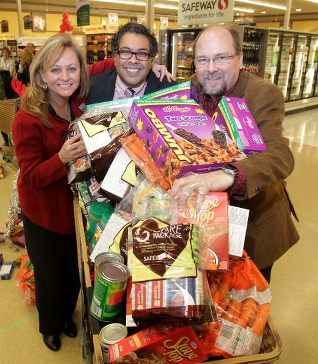 Calgary Mayor, Naheed Nenshi with Safeway's, Betty Kellsey and Calgary Inter-Faith Food Bank CEO, James McAra during the 25th Mayor's Annual Christmas Food Drive