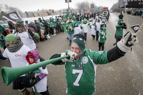 Riders superfan Scott Croissant blasts his horn while marching in the Grey Cup Parade in Regina yesterday during temperatures that dropped to a frigid -37C. (Lyle Aspinall/QMI AGENCY)