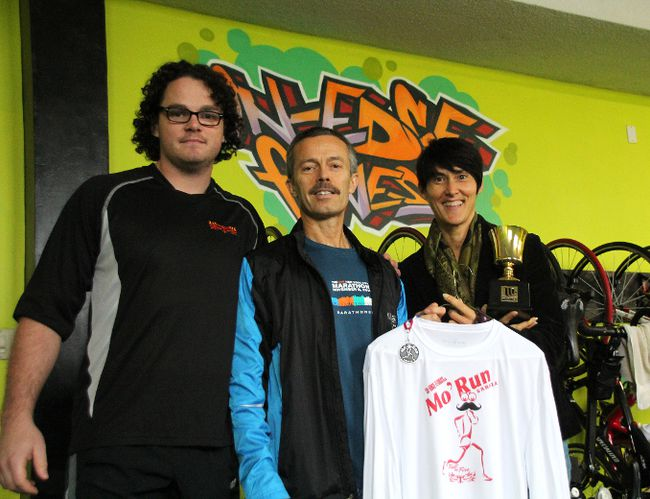 Stephen Norton, left, Cal Schram, centre, and Stefania Barron hosted Sarnia's largest Movember event: Mo' Run Sarnia on Sunday. Organizers estimate the event raised more than $9,000 for prostate cancer research. MELANIE ANDERSON/THE OBSERVER/QMI AGENCY