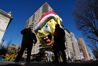 The Spongebob Squarepants balloon floats down Central Park West during the 87th Macy's Thanksgiving Day Parade in New York on November 28, 2013. (REUTERS/Gary Hershorn)