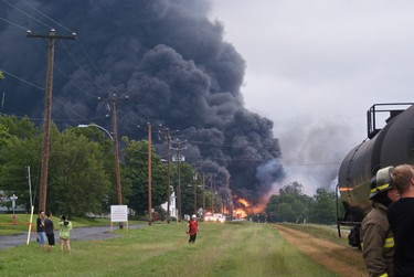 Smoke billows from a massive fire caused by a crude oil explosion after a train derailment in Lac Megantic, Que., July 6, 2013. Steve Poulin / QMI Agency
