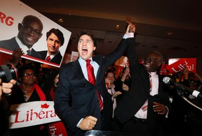 Liberal leader Justin Trudeau celebrates the byelection victory of  Liberal candidate Emmanuel Dubourg in the Bourassa riding in Montreal on November 25.   CHRISTINNE MUSCHI/REUTERS