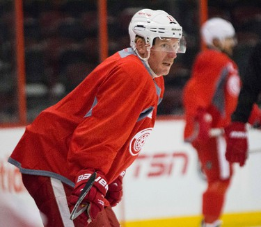 Daniel Alfredsson skated in a practice with his Detroit Red Wings at the Canadian Tire Centre in Ottawa on Saturday November 30,2013. This is the first time back on the ice in Ottawa since signing as a free agent with the Wings in July after playing 18 years with the Senators. Errol McGihon/Ottawa Sun/QMI Agency