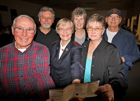 Salvation Army Pastor Starr Ferris (front and centre) was pleased to accept a $1,300 cheque for Christmas initiatives from Larry Donnelly (front left) and Sharon Brinn (right) Saturday evening during the Tri-County Jamboree in the Avondale United Church lower hall. In the back row, are: Oliver Gauld, Elaine Gauld and Don Brinn. Jeff Tribe/Tillsonburg News