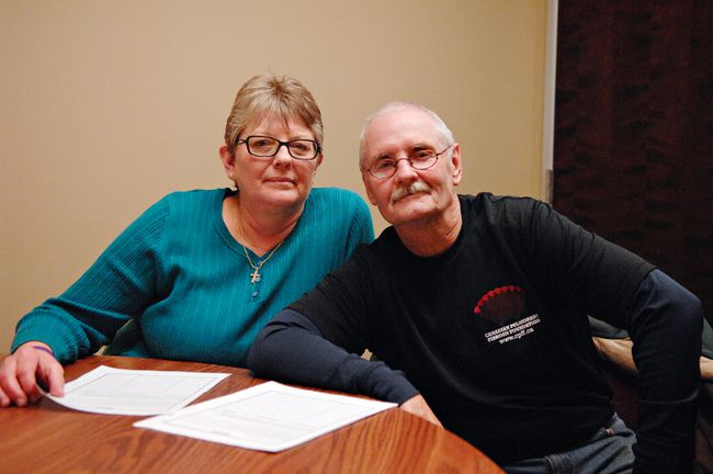 Roger Chandler and his wife, Karen, show a petition that the Canadian Pulmonary Fibrosis Foundation is circulating as part of a campaign to obtain public funding for an expensive drug that slows a rare fatal lung disease. (Michael-Allan Marion, The Expositor)