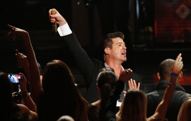 "Robin Thicke performs ""Blurred Lines"" at The Grammy Nominations Concert Live - Countdown to Music's Biggest Night event at Nokia theatre in Los Angeles December 6, 2013. The 56th annual Grammy Awards will be presented January 26, 2014 in Los Angeles.  REUTERS/Mario Anzuoni"