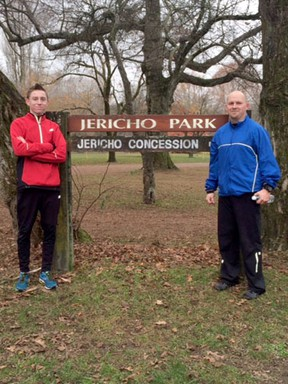 Royden Radowits (left) stands with coach and FMHS principal Gregg McNeil (right) beside the junior men's national course at Jericho Beach in Vancouver, B.C. Radowits placed 39th at the junior men's nationals Nov. 30.