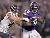 Minnesota Vikings running back Adrian Peterson (28) is tackled by Chicago Bears safety Chris Conte (47). (Brace Hemmelgarn-USA TODAY Sports)