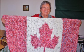 Shirley Kleine Deters shows off her 'pride and joy,' a small blanket made entirely out of Beatrice milk bags. The Sarnia woman has made more than seven dozen blankets to be sent to impoverished regions of the world to help combat infections. HEATHER BROUWER/ SARNIA THIS WEEK/ QMI AGENCY