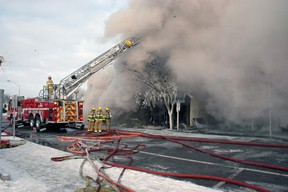 A thick pall of smoke covered much of the city Thursday as firefighters dealt with a major blaze that destroyed three businesses including a methadone clinic.  Ian McCallum/Times-Journal