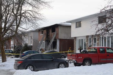 Two young women were killed early Saturday morning, Dec. 14, 2013, after a fire broke out at a Claymor Ave. home shortly before 3 a.m. Several others were injured. Chris Hofley/Ottawa Sun/QMI Agency