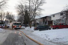 Two young women were killed early Saturday morning, Dec. 14, 2013, after a fire broke out at a Claymor Ave. home in the west end shortly before 3 a.m. Several others were injured.  Chris Hofley/Ottawa Sun/QMI Agency