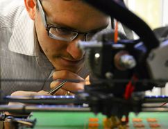 3D printer making tiny game pieces. (Postmedia Network file photo)