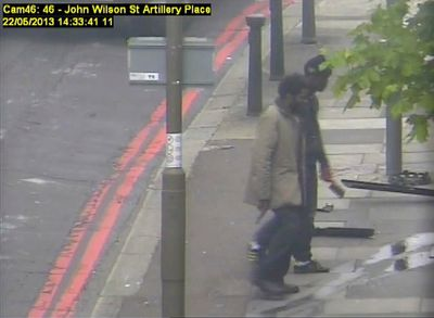 Michael Adebowale (L) and Michael Adebolajo walk back to the south footpath of Artillery Place in Woolwich in this handout still image taken from May 22, 2013 CCTV footage by the Metropolitan Police, that was shown to the jury during the Lee Rigby murder trial at the Old Bailey in London December 3, 2013. The two men are accused of running over British soldier Drummer Lee Rigby, 25, as he crossed a street in Woolwich, southeast London, in May before attacking his unconscious body with a meat cleaver and knives. REUTERS/Metropolitan Police/Handout via Reuters