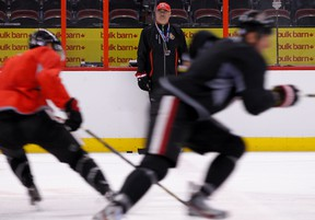 Ottawa Senators head coach Paul MacLean watches his players skate lines at the end of practice at Canadian Tire Centre in Ottawa on Tuesday October 1,2013. Errol McGihon/Ottawa Sun/QMI Agency