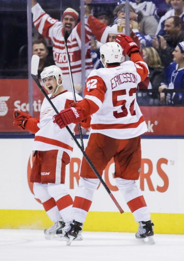 Detroit Red Wings celebrate the tying goal against the Toronto Maple Leafs during third-period action at the Air Canada Centre on December 21, 2013. (Ernest Doroszuk/Toronto Sun/QMI Agency)