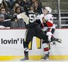 Ottawa Senators' Jean-Gabriel Pageau is checked by Pittsburgh Penguins' Kris Letang during NHL Eastern Conference Semifinal playoff hockey action at the Consol Energy Center in Pittsburgh, Pennsylvania on Friday May 24 ,2013. Errol McGihon/Ottawa Sun/QMI Agenc