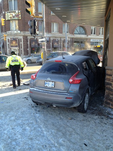 Two cars were involved in aserious collision at River Avenue and Osborne Street the morning of Dec. 23, 2014. One car struck the old Papa George's building, which was hoping to open under new owners soon. (RICH POPE/Winnipeg Sun)