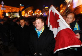 Canadian Foreign Minister John Baird visits the opposition camp at Independence Square in Kiev, Ukraine, on Dec. 5. The protests followed the Ukrainian government's U-turn away from Europe back towards Russia. (REUTERS)