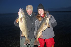 Chris Irwin, of Missouri, and Ashley Rae display some trophy walleye caught in the Bay of Quinte during a photo shoot on Dec. 13. (Supplied photo)