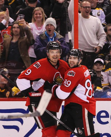 Ottawa Senators' Milan Michalek (L) and Corey Conacher celebrate Conachers goal against the Boston Bruins'  during NHL hockey action at the Canadian Tire Centre in Ottawa on Saturday December 28, 2013. Errol McGihon/Ottawa Sun/QMI Agency