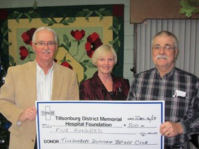 The Tillsonburg Duplicate Bridge Club made a series of Christmas donations this year. In this photo, Tillsonburg District Memorial  Hospital Foundation representative Dave Corner (left) accepts a $500 donation from bridge club members Diana May and Bill Misener. Contributed Photo