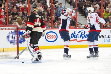 Washington Capitals left wing Jason Chimera (25) celebrates goal scored by right wing Joel Ward (42) against Ottawa Senators goalie Craig Anderson (41) in the first period at the Canadian Tire Centre. Marc DesRosiers-USA TODAY Sports