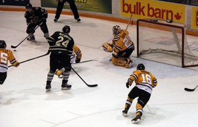 London Knights' forward Brett Welychka (number 27) looks for a lane to pass to teammate Michael McCarron during the third period of the Sarnia Sting vs London Knights game on New Year's Day in Sarnia. The Knights won the contest 8-6, and the Sarnia Sting are looking to rebound back against Kitchener on Friday night. SHAUN BISSON/THE OBSERVER/QMI AGENCY