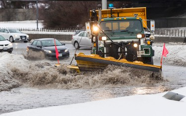 A plough clears water from the Maitland Avenue off ramp from the Queensway in Ottawa. January 6, 2014. Errol McGihon/Ottawa Sun/QMI Agency