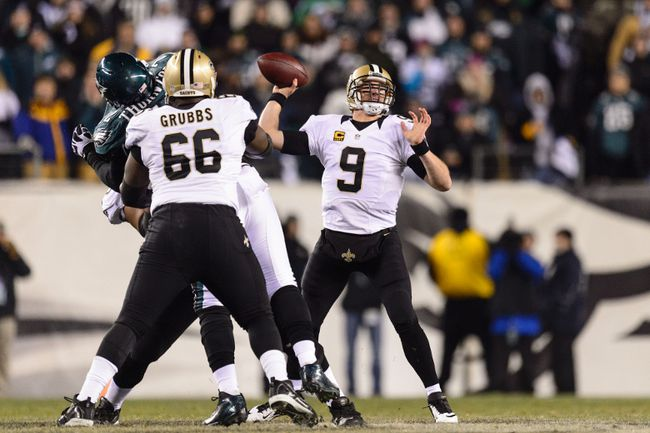 Saints quarterback Drew Brees (right) passes for a completion Saturday night in a win against the Eagles in Philadelphia. (USA TODAY SPORTS)