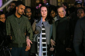 The family of Mark Duggan, (L-R) brother Marlon, mother Pamela and aunt Carol, stand outside the High Court in London on January 8, 2014. (REUTERS/Stefan Wermuth)