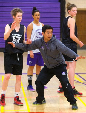 Head coach Brian Cheng directs the Western women?s basketball squad during practice at Thames Hall on Friday.  (MIKE HENSEN, The London Free Press)