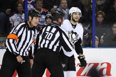 Pittsburgh defenceman Kris Letang (58) is called for a penalty after hitting forward Mark Arcobello (26) in the first period of a NHL game as the Edmonton Oilers play the Pittsburgh Penguins at Rexall Place in Edmonton, Alta., on Friday, Jan. 10, 2014. Ian Kucerak/Edmonton Sun/QMI Agency
