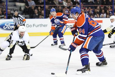 Edmonton forward Nail Yakupov (64) controls the puck against Pittsburgh in the first period of a NHL game as the Edmonton Oilers play the Pittsburgh Penguins at Rexall Place in Edmonton, Alta., on Friday, Jan. 10, 2014. Ian Kucerak/Edmonton Sun/QMI Agency