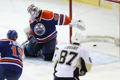 Edmonton goaltender Devan Dubnyk (40) is scored on by Pittsburgh forward Sidney Crosby (87) during the second period of a NHL game as the Edmonton Oilers play the Pittsburgh Penguins at Rexall Place in Edmonton, Alta., on Friday, Jan. 10, 2014. Ian Kucerak/Edmonton Sun/QMI Agency