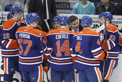 Edmonton head coach Dallas Eakins speaks with his players during a timeout called in the third period of a NHL game as the Edmonton Oilers play the Pittsburgh Penguins at Rexall Place in Edmonton, Alta., on Friday, Jan. 10, 2014. The Oilers won 4-3 in overtime. Ian Kucerak/Edmonton Sun/QMI Agency