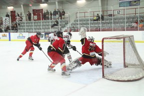 Red Lake goalie Breton Burke goes all out to make the save during their game against the St. Thomas Aquinas Saints on Jan. 11.