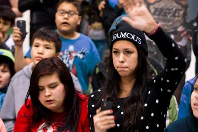 Desaree Boudreau, 14, asks UFC fighter Georges St. Pierre a question at the Crystal Kids Youth Centre before the Edmonton Rush's season home opener in Edmonton, Alta., on Saturday, Jan. 11, 2014. St. Pierre, who is taking a break from the UFC, was in town promoting the lacrosse team. Ian Kucerak/Edmonton Sun/QMI Agency